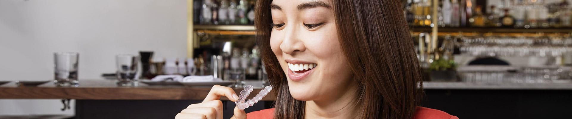 feature-Image-invisalign-woman-aligner at Central Michigan Orthodontics in Mt Pleasant and Clare MI